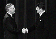 Mondale shakes hands with Ronald Reagan before a debate in 1984.