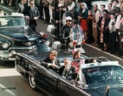 The Presidential limousine before the assassination. Jacqueline is in the backseat to the President's left.