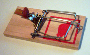 A baited and primed mousetrap.