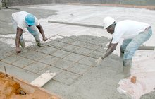 Installing rebar in a floor during a concrete pour