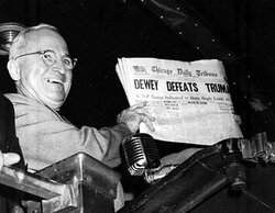 The Chicago Daily Tribune, like most of the press, believed Dewey would comfortably win the election, as shown by this post-election headline, which Harry Truman happily displays in this photo.