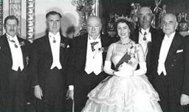 HM the Queen with Commonwealth Prime Ministers, in the . To her right, ; to her left,  of Australia and  of Canada. They wear evening dress with decorations.