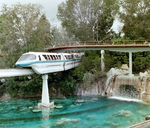 Monorail Blue travels over the Submarine Voyage lagoon in Tomorrowland.