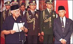 On  , after enormous political pressure and numerous demonstrations, the revolutionaries gained their prize: Suharto announces his resignation on Indonesian TV