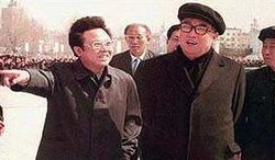 Kim Jong-il (left), with his father .