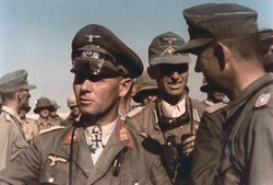 German General Rommel (facing left) 1941, was defeated in spite of his military brilliance