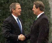 Al Gore greets President-Elect Bush at the White House in late December of 2000.