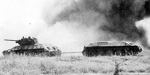A Soviet  tank towing a damaged armoured vehicle at the  in July 1943. The Soviet Union manufactured 40,000 T-34s during the war.