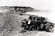 Dieppe's pebble beach and cliff immediately following the raid on August 19th, 1942. A scout car has been abandoned.