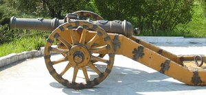 A small cast-iron cannon on a carriage