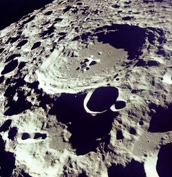 Lunar astronomy: the large crater is , photographed by the crew of  as they circled the  in 1969.  Located near the center of the  of Earth's Moon, its diameter is about 58 miles (93 km).