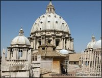 The dome designed by Michelangelo was completed by Giacomo della Porta in 1590.