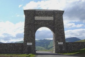 "North Gate to Yellowstone Park at Gardiner, Montana which says ""For the Benefit and Enjoyment of the People"""