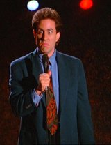 "Jerry Seinfeld performing his famous stand-up comedy at the ending of an episode (""The Boyfriend Part. 2)"