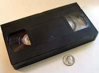 Top view VHS cassette with US Quarter for scale