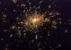 London by night as seen from the . The   can be seen ringing the city, most notable here to the south, and two dark spots on the edge of the densely packed lights of  are just noticeable in this thumbnail view:  and .
