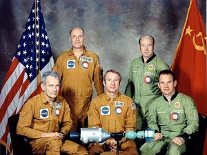 Brand (seated center) poses with the rest of the American and Soviet crew of Apollo-Soyuz